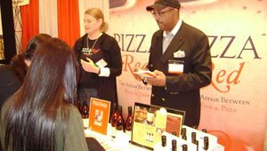 Jerry Cogen of the Pizza Wine Co. talks to attendees at the 15th Annual International Restaurant & Foodservice Show of New York. Cogen was discussing Pizza Red, an Australian wine made to drink with pizza.