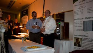 Dave Brewer and David Moore, from Gold sponsor SpinFresh, listened while colleague Rory Milliken addressed the reception.