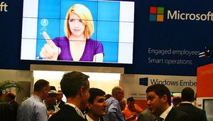 And Microsoft's video wall kept an eye on the nearly constant bustle at its booth.