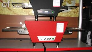 Savory's Synergy Conveyor Toaster utilizes infrared and convection heat and can toast 160 to 240 sandwiches per hour. Features include an air curtain to prevent heat loss and a removable crumb tray.