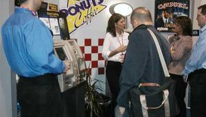 The mini c-store in the Tranax booth was popular with attendees, who lined up to see a check cashing demo by Financial Payments and to enjoy candy bars and other goodies on store shelves.