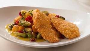 One of the restaurant's signature dishes is Art's Unfried Chicken with roasted squash, brussel sprouts, dried cranberries and Dijon vinaigrette.