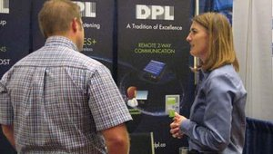 Jayne DeMerchant of The DPL Group speaks with an attendee.