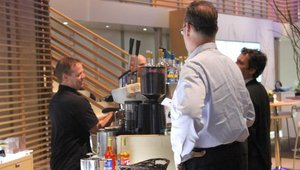 Qualcomm's booth was easily the most populated, in part, due to this barista whipping up free coffee treats.