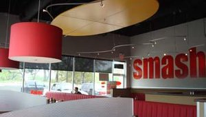 Smashburger features a clean, modern interior. A typical franchise agreement is for five to 10 or more locations. Potential franchisees also must have a minimum financial net worth of $2 million and liquidity of $500,000.