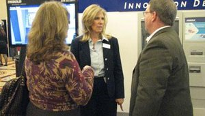 Terrie Ipson, center, is the marketing manager of ATM security for Diebold. During the forum, she spoke with attendees about Diebold's new ValiTech ATM-access control technology, which includes two-factor authentication.