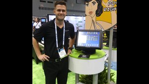 David Jones shows the ordering software for restaurants at the Revention, Inc. booth.