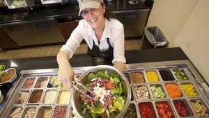 Chef Leslie Lenaway prepares one of the 17 million combinations of salads available at the restaurant.