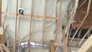 Closed-cell spray foam fills the rafter bays of the home's vaulted ceilings and provides a 2-inch layer of air sealing and insulating protection under 12 inches of blown cellulose on the flat-ceilinged portions of the home.