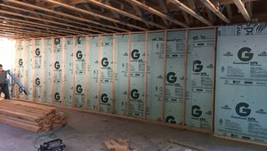 The poured concrete basement walls are insulated along the inside with 2.5 inches of R-12.5 polyiso rigid insulation.