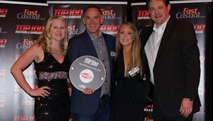 <p>Smashburger's Christine Ferris and Josh Kern receive the company's award.</p>