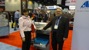 Zina Murray, a food safety consultant, learns about CMA dish washing machines from John Lacey at the CMA Dishmachines booth.