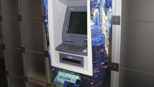 A customized wrap for the ATM surrounds helps FIs promote their brands and their services.