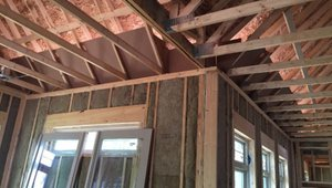 Baffles keep insulation out of the soffit vents and wind out of the insulation in this vented attic.