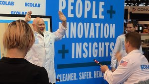 EcoLab reps talk about food safety and entertain the audience with a knife-throwing trick.