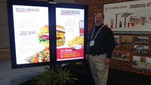 Doug Watson presents a new digital drive-thru ordering system at the Howard Company booth.