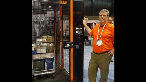 Kevin Dugan displays an inventory control solution for restaurants at the Apex Supply Chain Technologies booth.