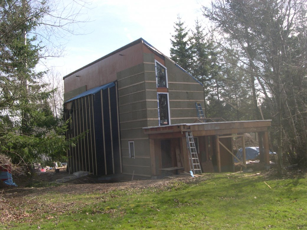 over the 2 by 6 framing the builder installed a continuous thermal blanket