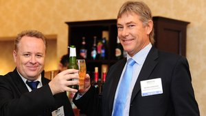 <p>Ken Metcalf and Peter Cordiner of event sponsor Locksmiths Wholesalers toast a successful trek from Cape Town, South Africa to Washington, D.C.</p>