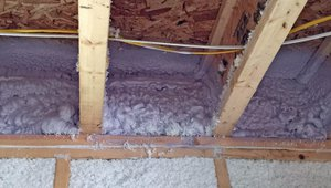 Spray foam insulates and air-seals the rim joists while R-23 of blown-in fiberglass insulation is densely packed into the 2-by-6 wall cavities. This, combined with the R-20 of rigid foam on the exterior, provides a total wall insulation value of R-43, more than twice the insulation amount required by code.