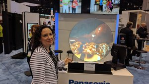 Nicole from Panasonic shows the company's new glass advertiser.