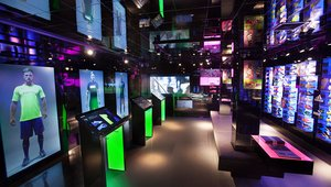 <p>Interactive digital mannequins feature life-size videos of players and models wearing the latest apparel.</p>