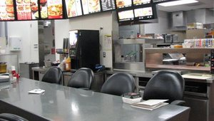 Carl's Jr. corporate staff hold meetings in the test kitchen where members can see the menu and brainstorm.