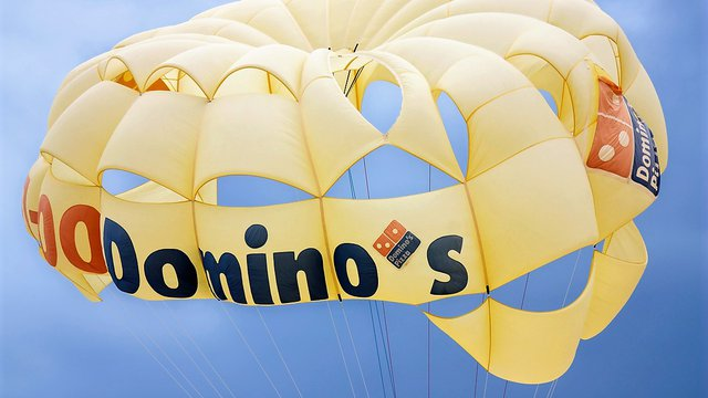 Domino's CEO leaves a chain reborn, flying high