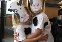 Chick-fil-A offered customers dressed like cows a free combo meal in honor of Cow Appreciation Day, July 10. The stores saw a variety of efforts, these girls used cow faces and cow spots available for download on the company website.
