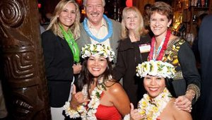 From left: Barbara Kane (Ecolab), Wally Doolin (Caribou Coffee), Joni Thomas Doolin (People Report) and Ann Nickolas (Women's Foodservice Forum), pose with members of Grace Hula Dance and Company.