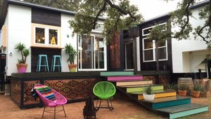 <p>Most tiny homes make use of outdoor living spaces like this one, and the bright colors make it inviting year around.</p>