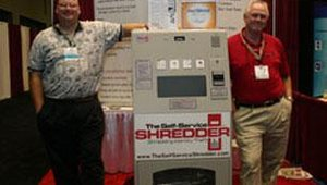 RealTime Shredding's kiosk is like my brother, Michael: It'll eat anything. Tony Rodenbaugh (left), account executive, and Johnny Podrovitz, vice president of business services, hoped to feed it some business.