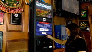 Touchscreen digital jukeboxes sing political song