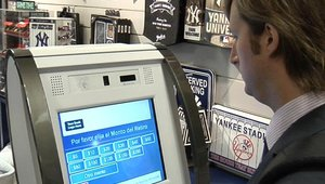 A customer in a Times Square Lids store tries out the new KAL cashless RTM.