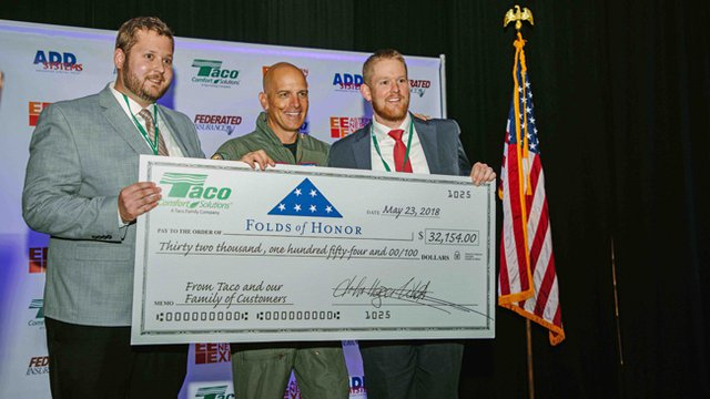 Taco presents Folds of Honor with donation