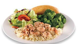 Captain D's mid-tier shrimp offering is its Shrimp Scampi Dinner, available for $4.99. The dinner features grilled shrimp on a bed of rice topped it with a buttery scampi sauce. It comes with a choice of two sides and a breadstick.