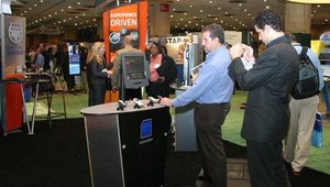 Jon Weinfeld and David Weinfeld, with W A Media Group, study the technology at Nanonation's booth.