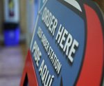 Domino's franchisee using self-service kiosks to reach college crowd