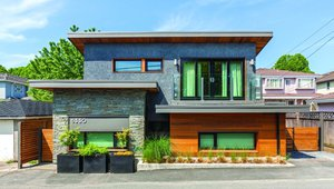 Solar Laneway House, Vancouver, British Colombia. This home was built in the laneway or backyard of a family member's existing home. SIPs construction. The house was built with 13-inch thick walls, including 6 1/2-inch SIPs and rock wall insulation on the inner service walls. The house is net zero for many months of the year. Photo by Colin Perry