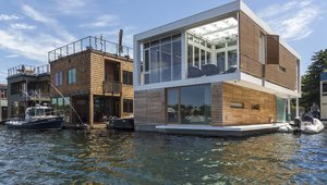 Stepping onto the float, one encounters a broad exterior deck that runs the length of the float; this deck leads to the front entry while also providing access to boat moorage adjacent to the float. The front entry features two exterior walls of channel glass, allowing abundant natural light for the entry and stair yet maintaining privacy.