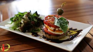 A favorite menu item is the Heirloom Tomato Tower, featuring fresh mozzarella, basil, field greens, sea salt, extra virgin olive oil and a balsamic glaze.
