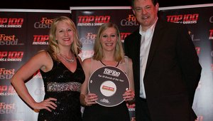 <p>Liz Jones, senior marketing manager, accepts Genghis Grill's award.</p>