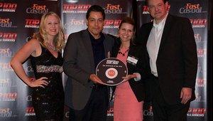 <p>Jim Bitticks and Kim Freer (center) receive Blaze Pizza's award.</p>