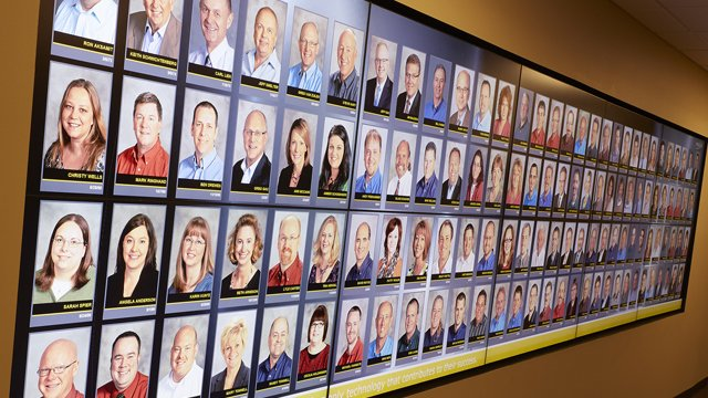 900-employee-photo digital signage video wall updates company tradition