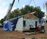 Systems-built homes rising from idle house boat factories (video)