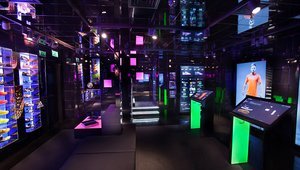 <p>The downstairs space allows customers to try on boots, and allows for player appearances, launch events and live match screenings.</p>
