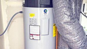 A high-efficiency heat pump water heater provides domestic hot water.