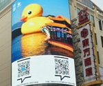 Rubber Duck floats onto digital billboards in China