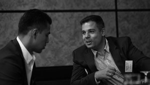 Jerry Gamez, Partner, EVP (left) and chief development officer of Consumer Investment Partners, chats with a fellow attendee.
