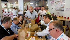 Attendees were ready for their sampling of Five Guys Burgers & Fries. The food tour, in its second year, was developed for the Fast Casual Executive Summit as a good way for operators to bond during the event.